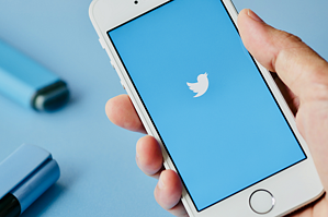 57-blue-screen-of-twitter-app-blurred-blue-marker-pen-as-background-440x229