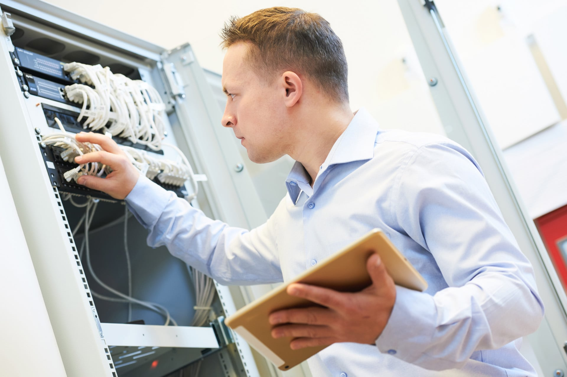 man-checking-server-cables.jpg